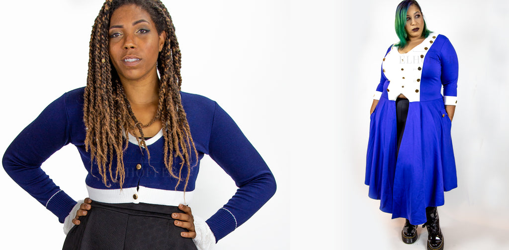 Aabria models the cropped blue long sleeved cardigan. Dawn models the blue coat inspired tunic with black leggings. Both are standing on a white background.