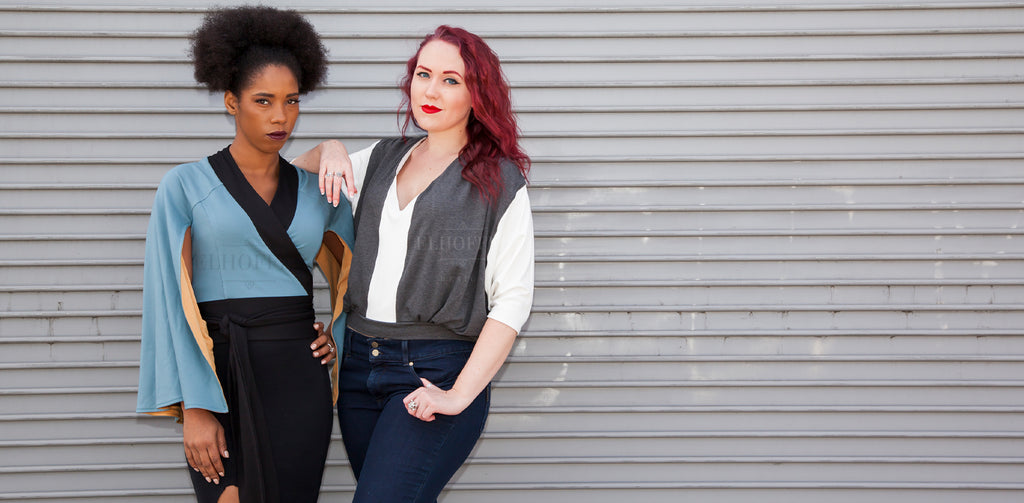 The model on the left is wearing the Galactic Baron Cape Wrap Top and the model on the right is wearing the Galactic Smuggler Oversize Crop.