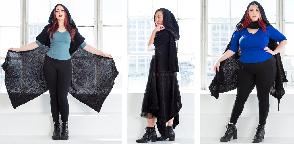 The three models wear the Galactic Renegade Hooded Cape in black in three different styles with the hood up.