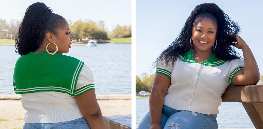 A model sits outdoors and shows the back and front of the green and white cropped cardigan. The back of the cardigan has a small green cape.