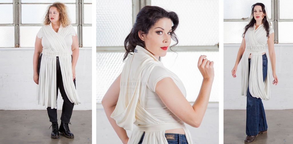 The models are wearing the Galactic Scavenger Hooded Crop Top in white.