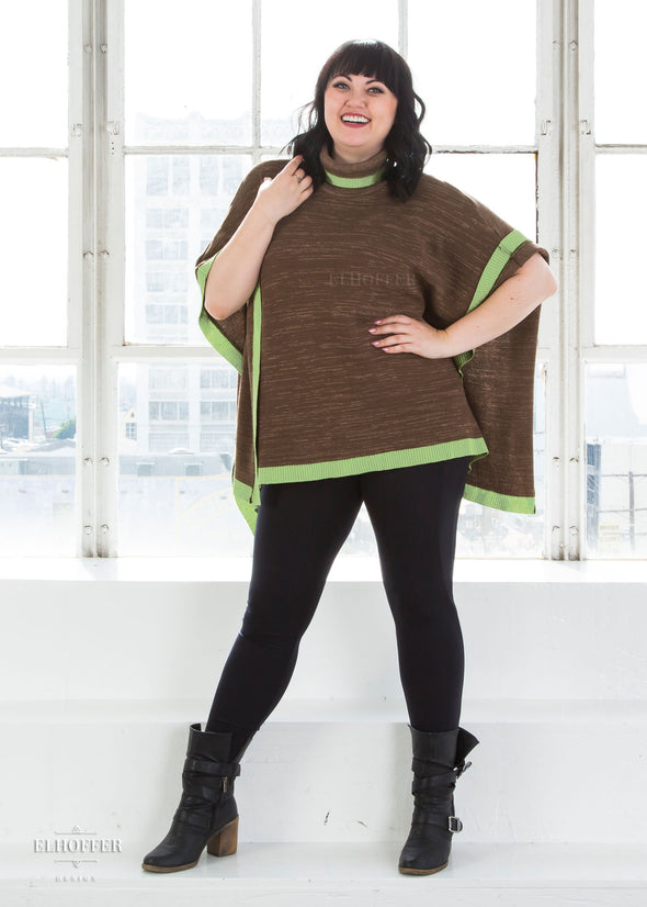 "Bernadette is modeling the One Size Cape. She has a 40"" Chest, 36.5"" Waist, 43"" Hip, and is 5'6"" and is a size L."
