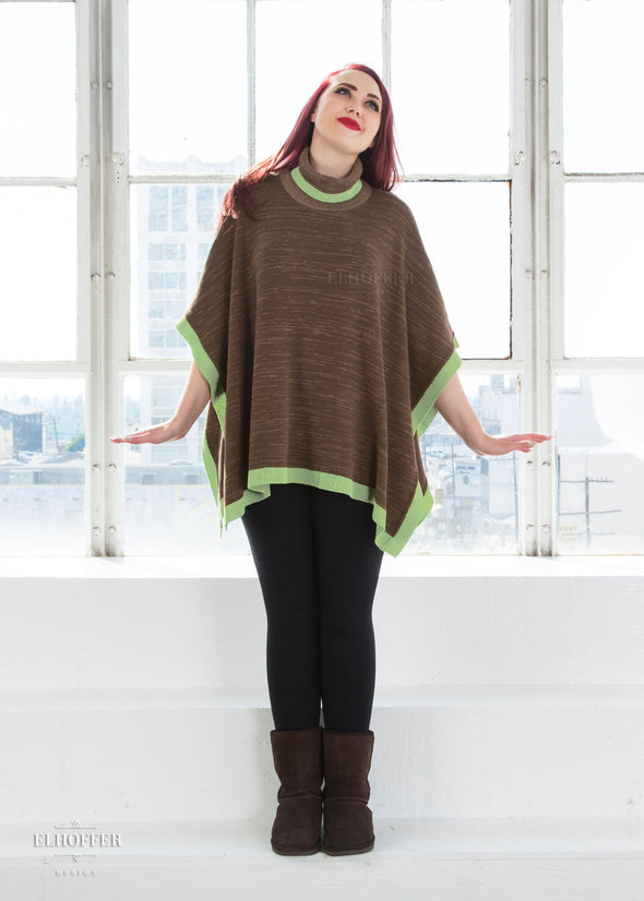 "Kelsey is modeling the One Size Cape. She has a 36"" Bust, 26"" Waist, 42"" Hip, and is 5'9"" and is a size S."