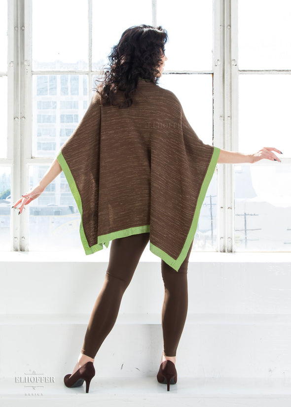 Kit pairs the multi shade brown poncho with our brown high waisted leggings and brown heels..