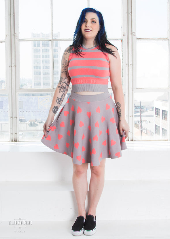 "Christina models the Medium size pink and gray crop top and skirt. She has a 40"" bust and 29"" waist."