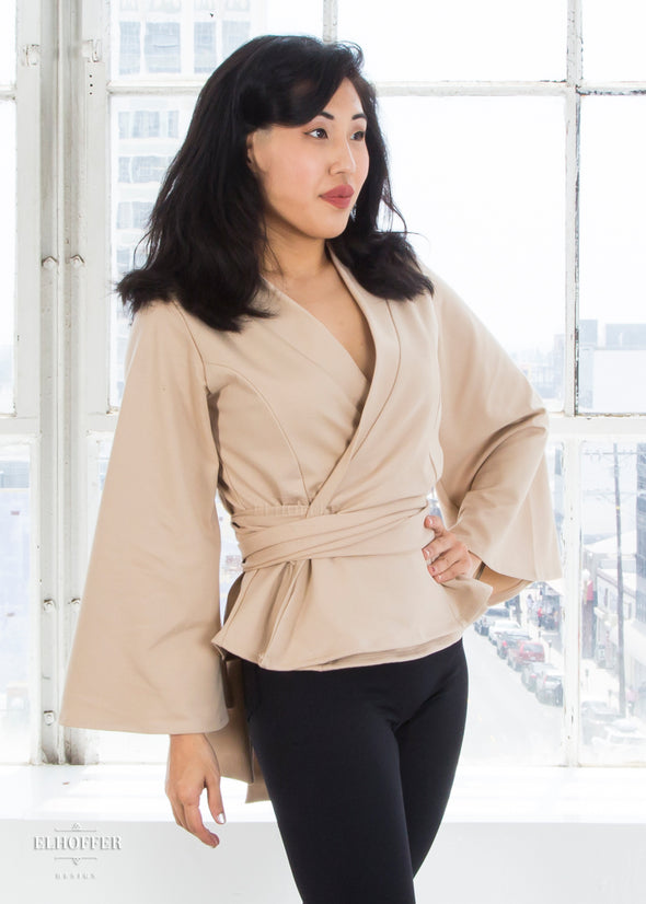 "Kate is modeling the XS sand wrap top. She has a 34"" Bust, 25"" Waist, 36"" Hip and is 5'2""."