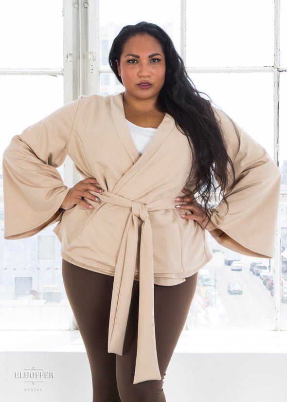 "Tas is modeling the 2X sand wrap top. She has a 48"" Bust, 39"" Waist, 49"" Hip and is 5'6""."