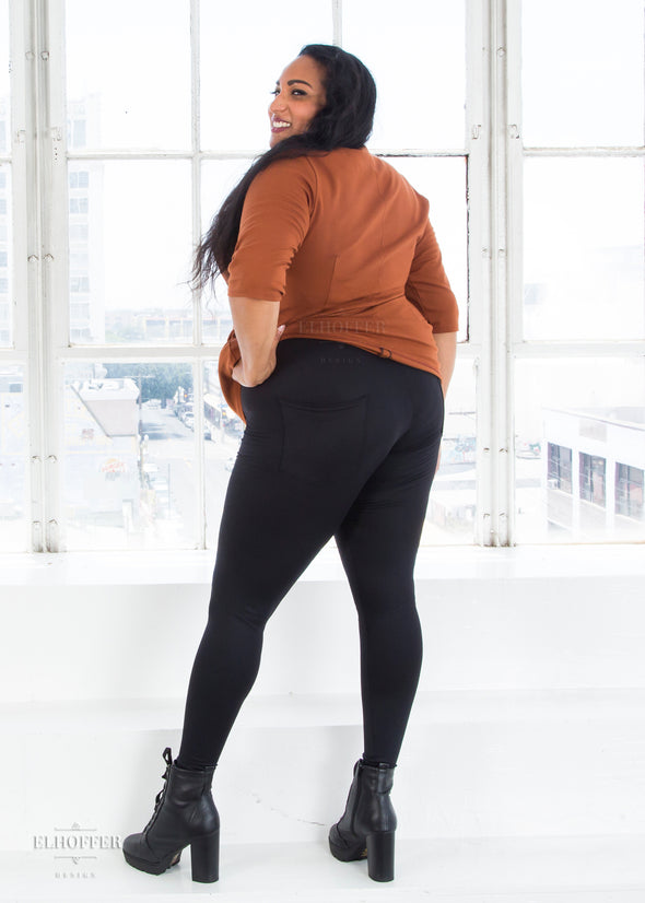 Tas pairs the black high waisted leggings with our copper longline Catherine top.