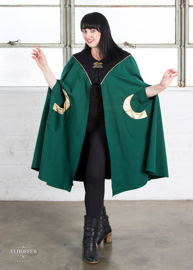 "Bernadette is modeling the One Size emerald green cloak with gold vinyl accents. She has a 40"" Chest, 36.5"" Waist, 43"" Hip, and is 5'6""."