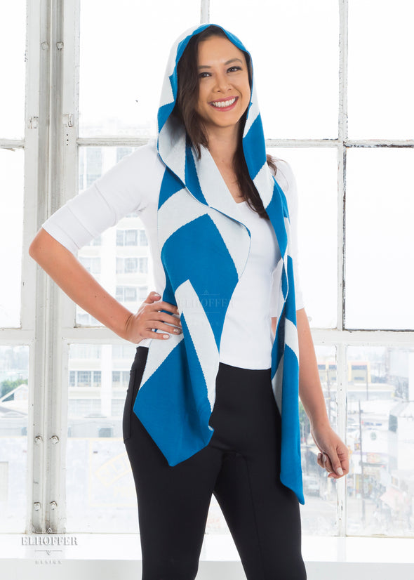 Kim models the blue and white patterned knit scarf with hood.