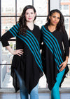 Devan and Malinda model the striped tunic. Devan pairs hers with jeans and Malinda pairs hers with our teal high waisted leggings.