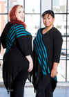 Katie Lynn and Nik are modeling the tunic, which is a black knit tunic with 5 teal stripes from the right shoulder to left hip.