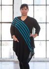 "Nik is modeling the L teal striped tunic. She has a 43"" Bust, 34"" Waist, 44"" Hip, and is 5'6""."