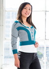 "Alice is modeling the S teal cardigan. She has a 34"" Bust, 28"" Waist, 39"" Hip, and is 5'2"""