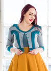 "Kelsey is modeling the M teal cardigan, but would order a S. She has a 36"" Bust, 26"" Waist, 42"" Hip, and is 5'9""."