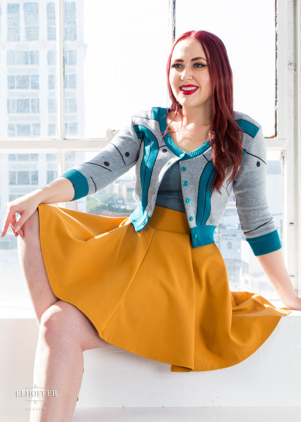 Kelsey pairs the teal cardigan with our yellow skater skirt.