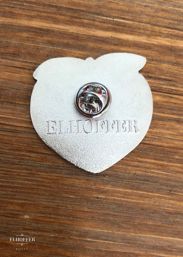 The back of nickel plated pin with Elhoffer logo.