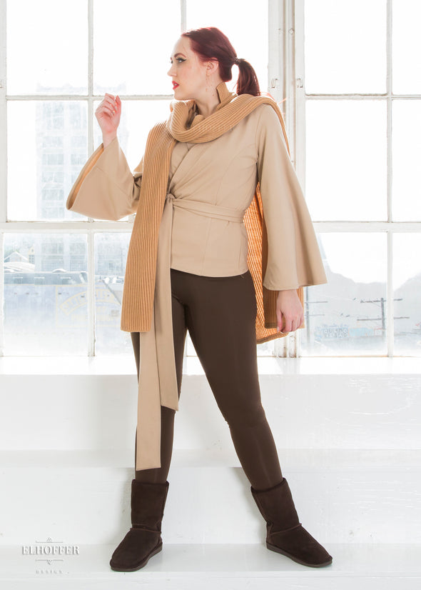 Kelsey models the tabard with the left poncho piece over her right shoulder, creating a scarf look.