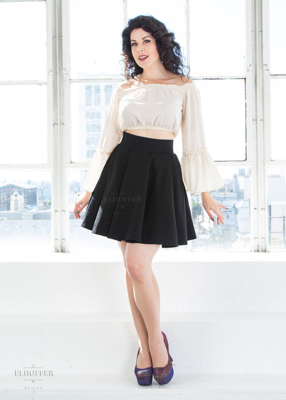 "Kit is modeling the XS black skater skirt. She is 5'7"" and has a 36"" Bust, 26"" Waist, and 38"" Hip."