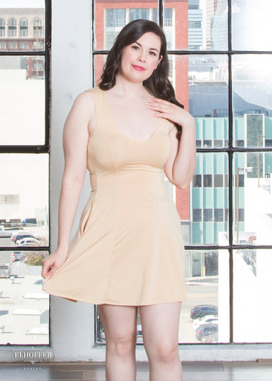 "Devan is wearing a M almond slip dress. She has a 40"" Bust, 31"" Waist, 42"" Hip, and is 5'8""."