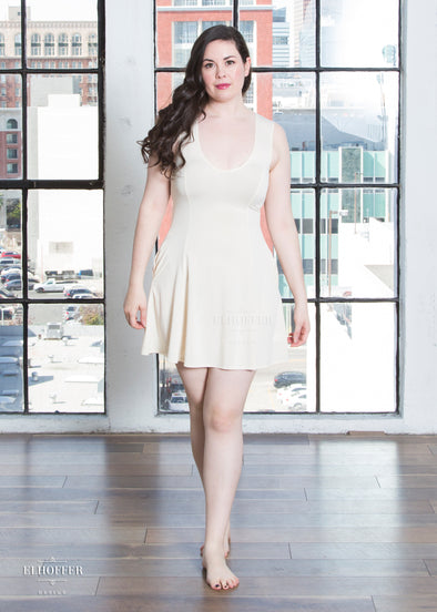 "Devan is wearing a M vanilla slip dress. She has a 40"" Bust, 31"" Waist, 42"" Hip, and is 5'8""."