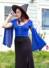 "Kelsey is modeling the Small cropped blue cardigan. She has a 36"" Bust, 26"" Waist, 42"" Hip, and is 5'9""."