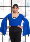 "Nik is modeling the Production Large cropped blue cardigan. She has a 43"" Bust, 34"" Waist, 44"" Hip, and is 5'6""."
