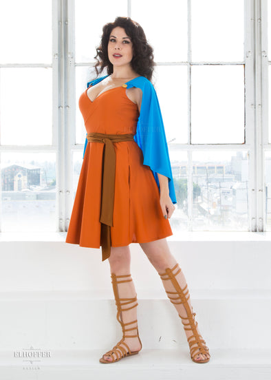 "Kit is modeling the Sample M orange midi dress but would order a S or XS. She is 5'7"" and has a 36"" Bust, 26"" Waist, and 38"" Hip."