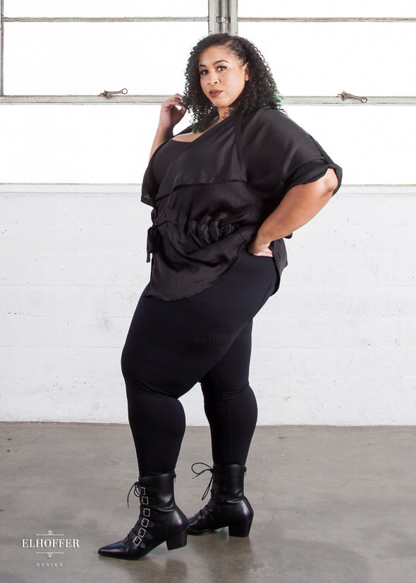 "Dawn is wearing the 3XL black high waisted leggings. She is 5'6"" and has a 51"" Bust, 44"" Waist, and 58"" Hip."
