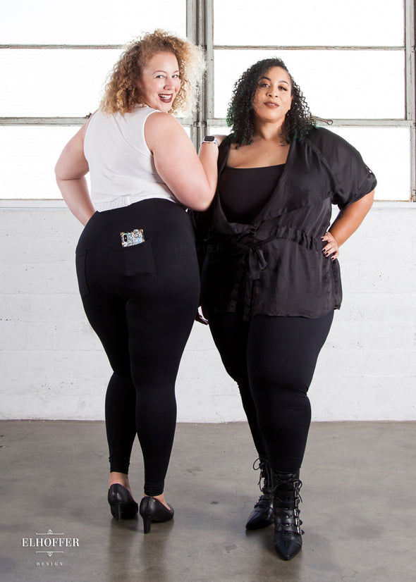 Anastasia and Dawn model the black high waisted leggings.