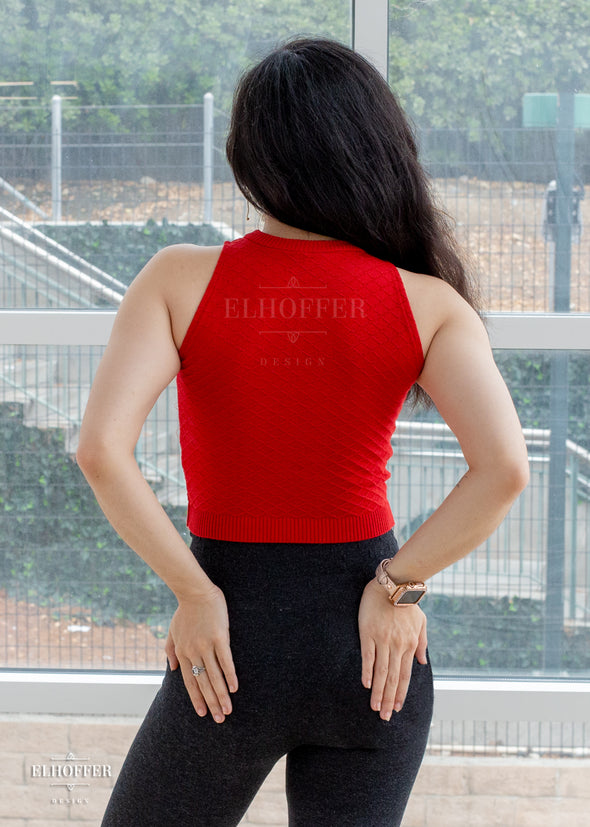 Malinda models the back of the red Catherine top. The hem falls to her mid hip. She is 5'3.