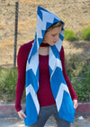 Courtney  models the blue and white patterned knit scarf with hood.