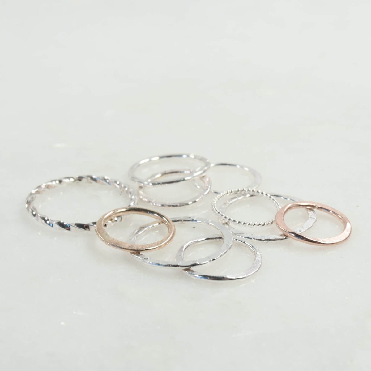 circle shapes in silver gold and pink gold