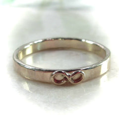 Infinity shape on hand stamping ring