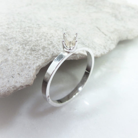2mm band with 4 prong setting in silver