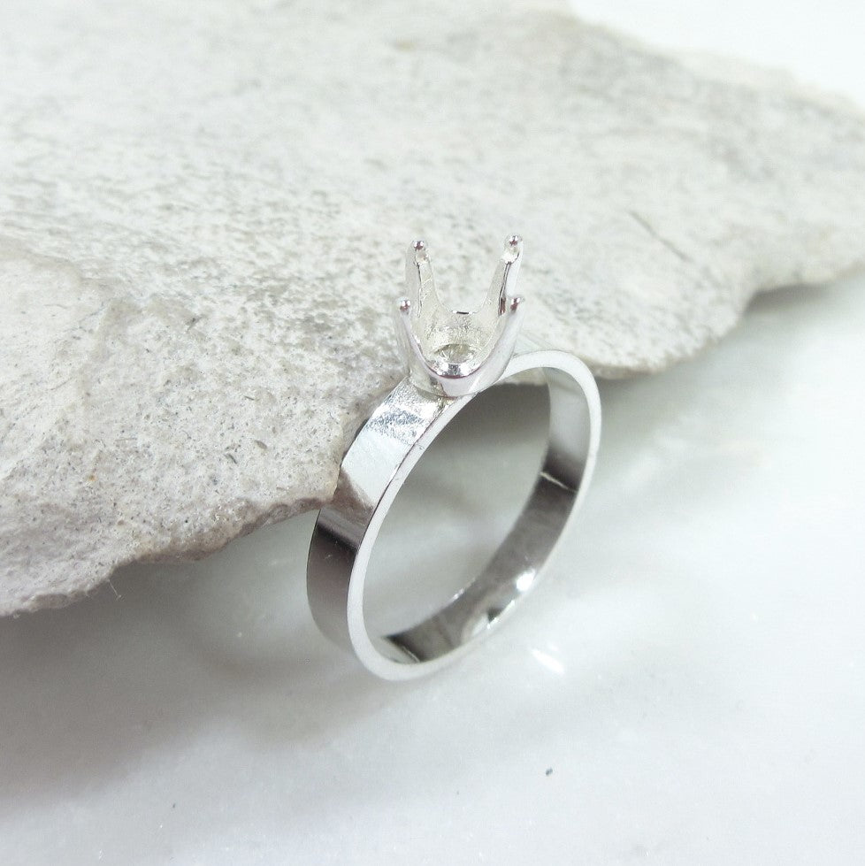 above view silver 4 prong ring setting