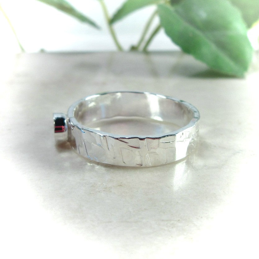 side view 3mm silver band with bezel cup setting
