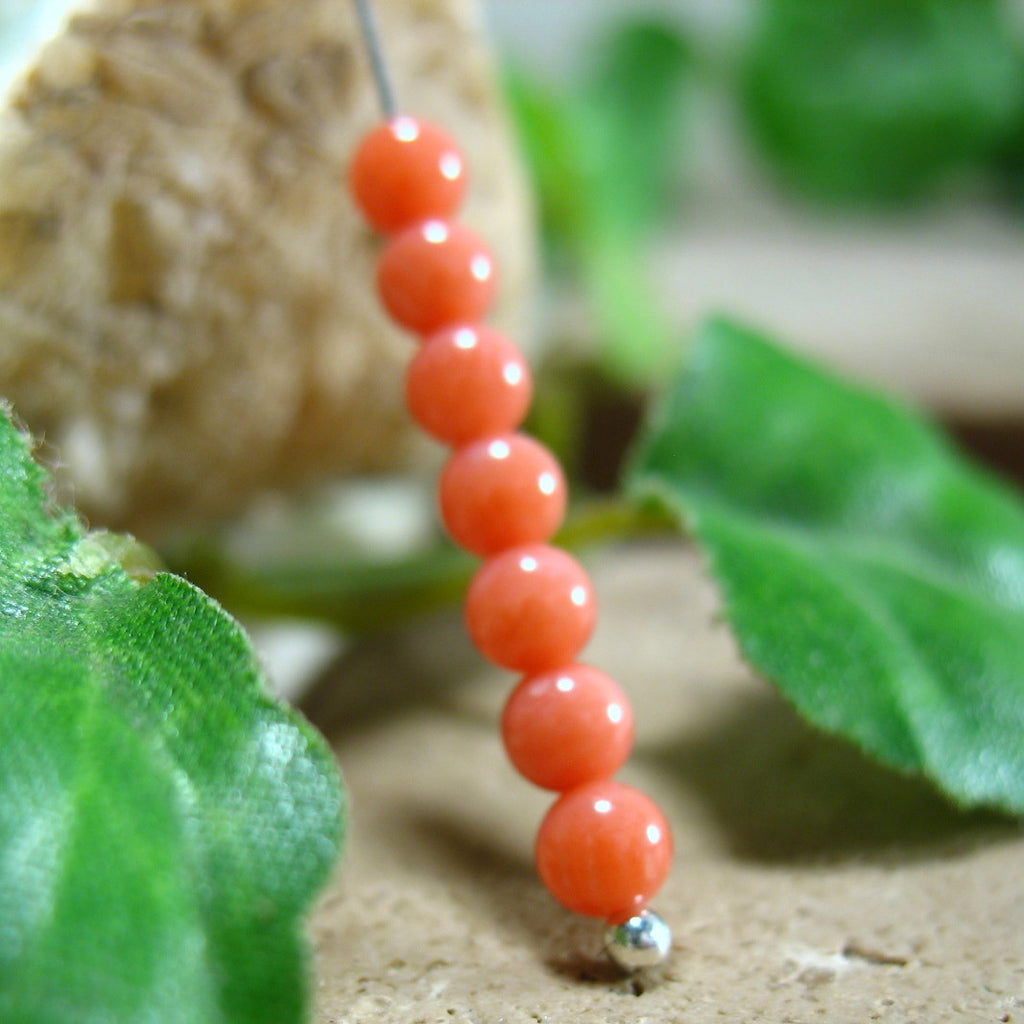 Coral beads on a headpin