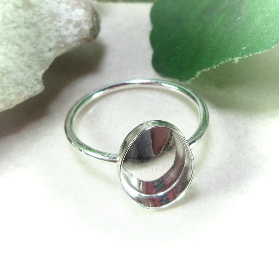 over view of oval ring setting in silver