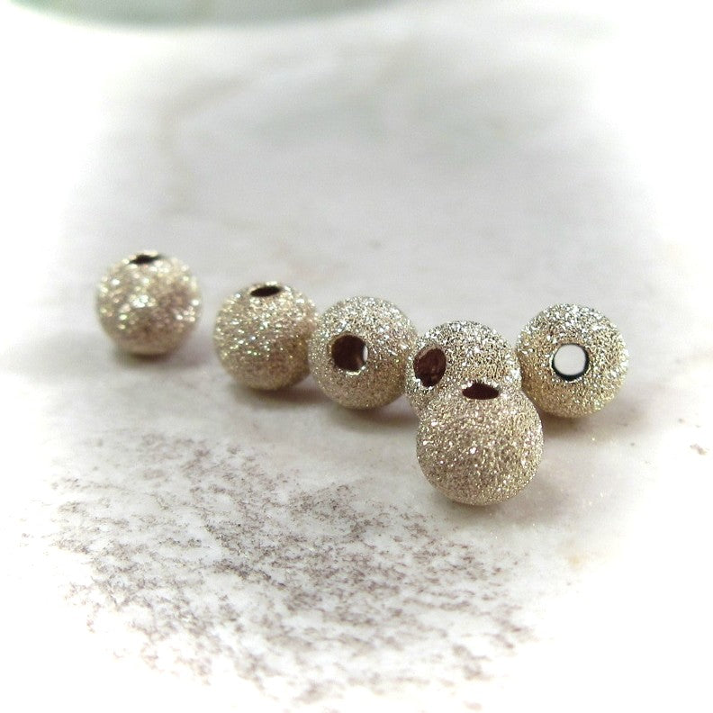 gold stardust beads