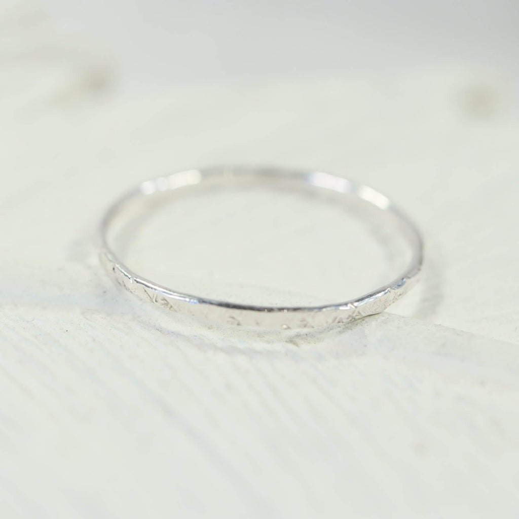 feathered thin band ring silver