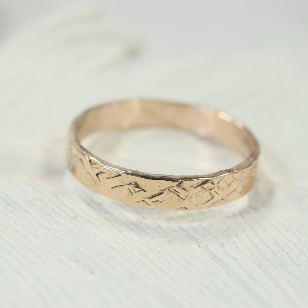 5mm chiseled stamping ring gold