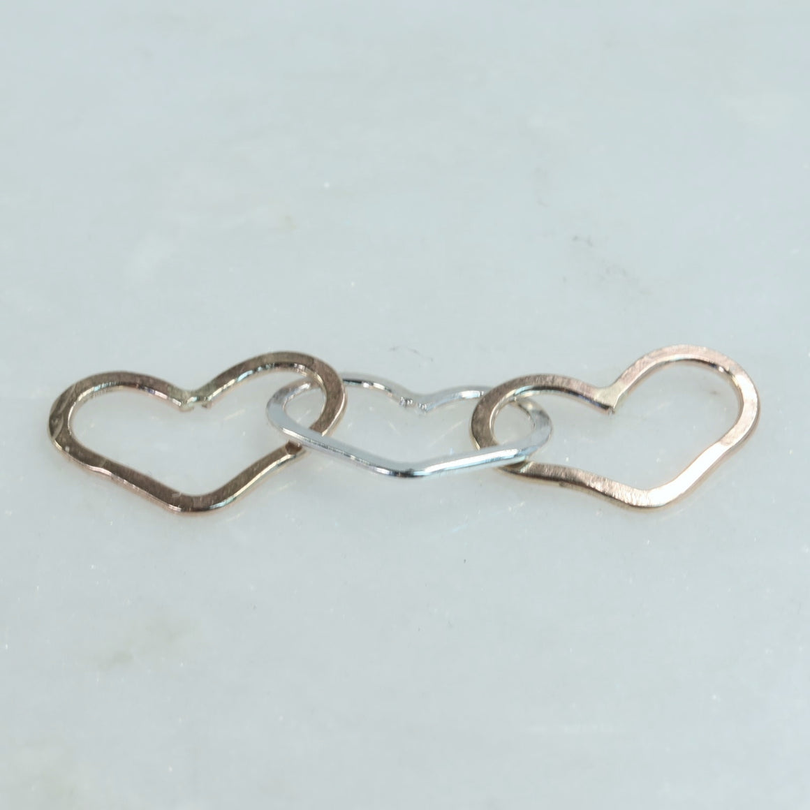 3 hearts linked connectors gold & silver