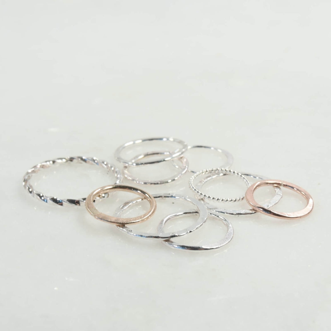 circle shapes in silver, gold and pink gold