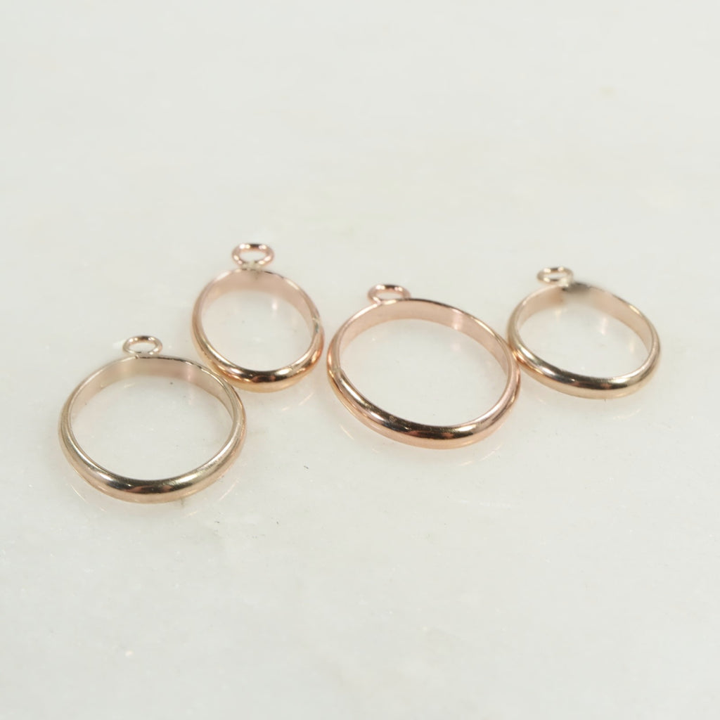 oval open bezel gold and pink gold