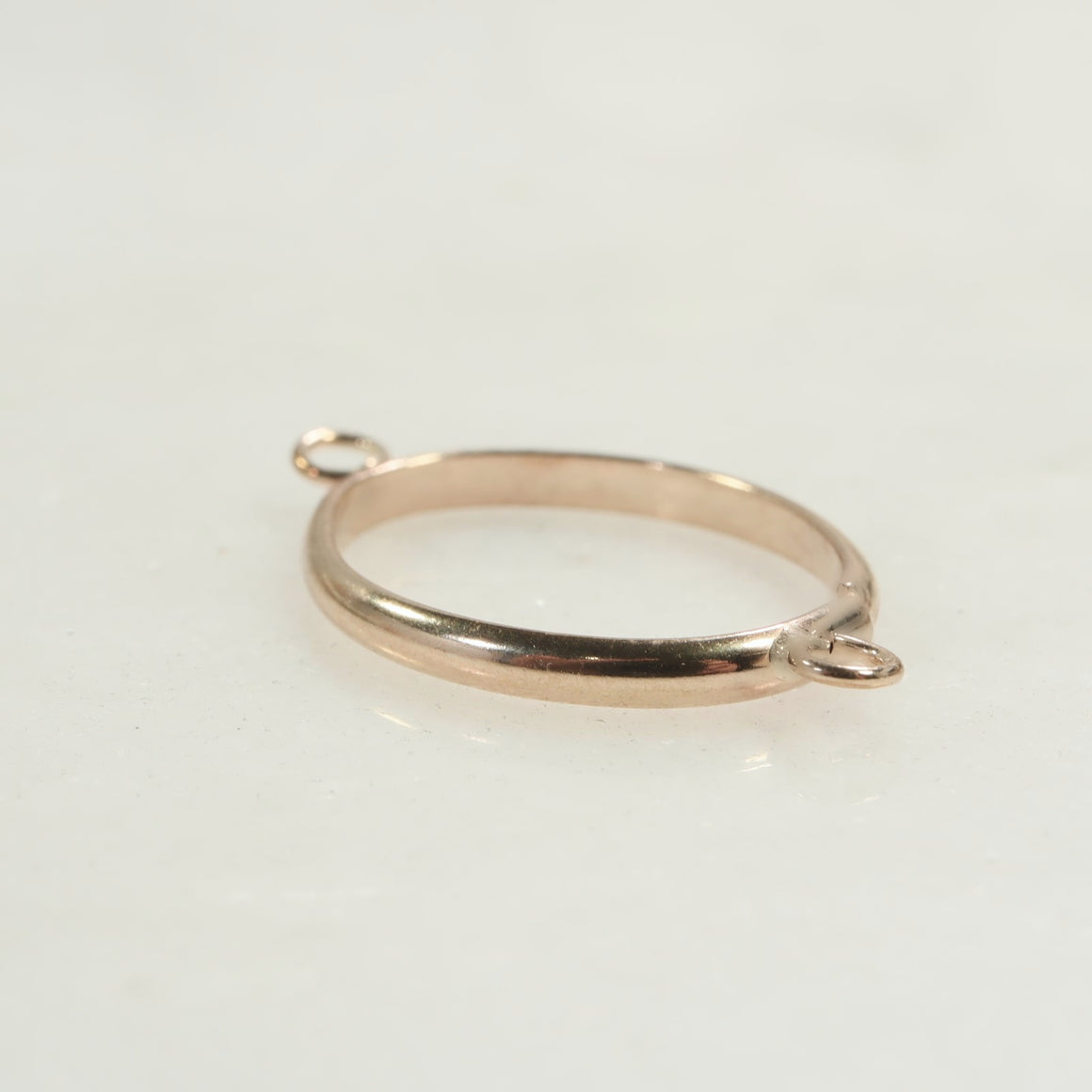 gold oval open bezel with 2 rings