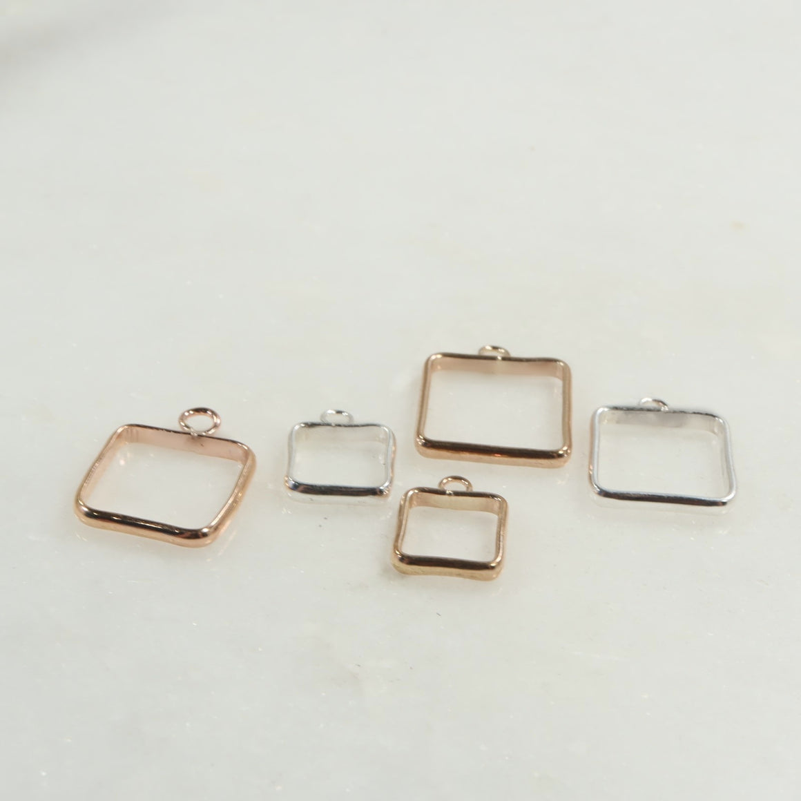 square open bezels in silver, gold, pink gold