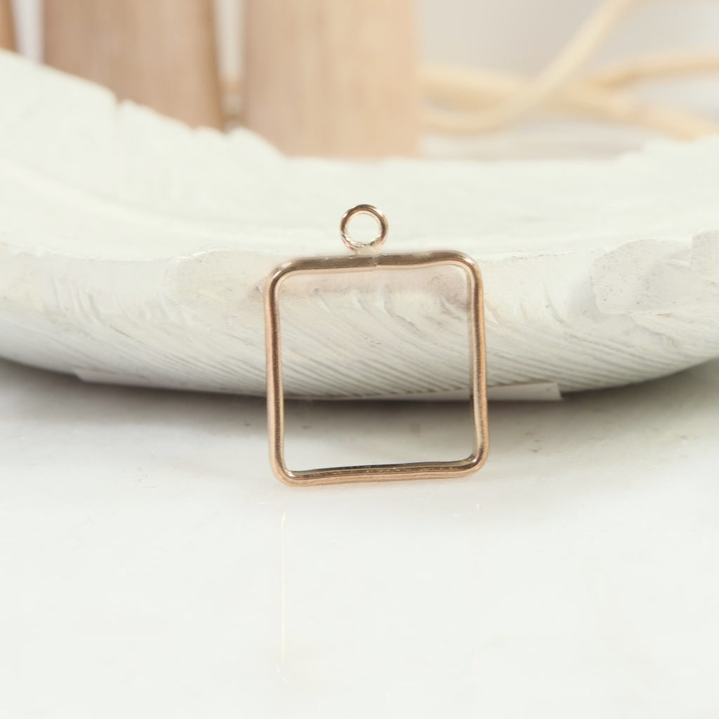 square open bezel with single ring gold
