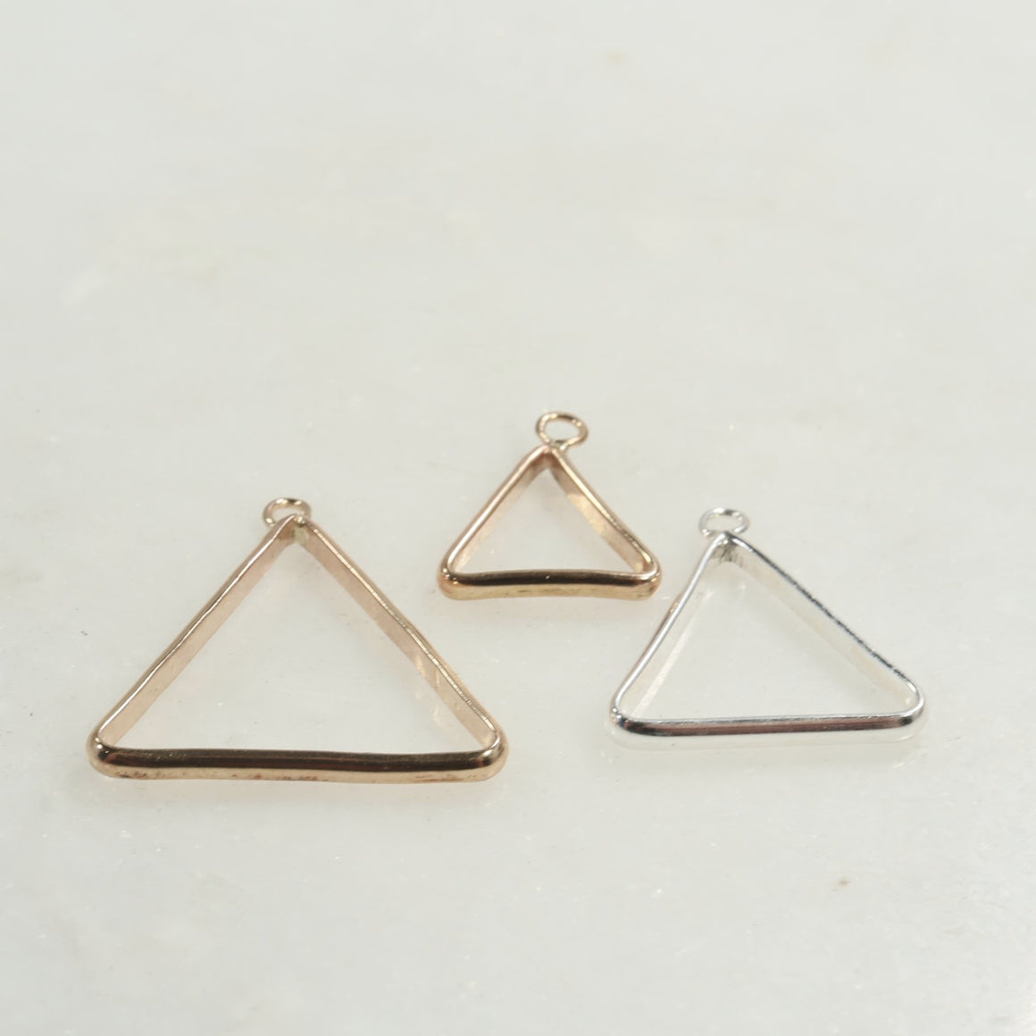 triangle open bezel in silver, gold and pink gold