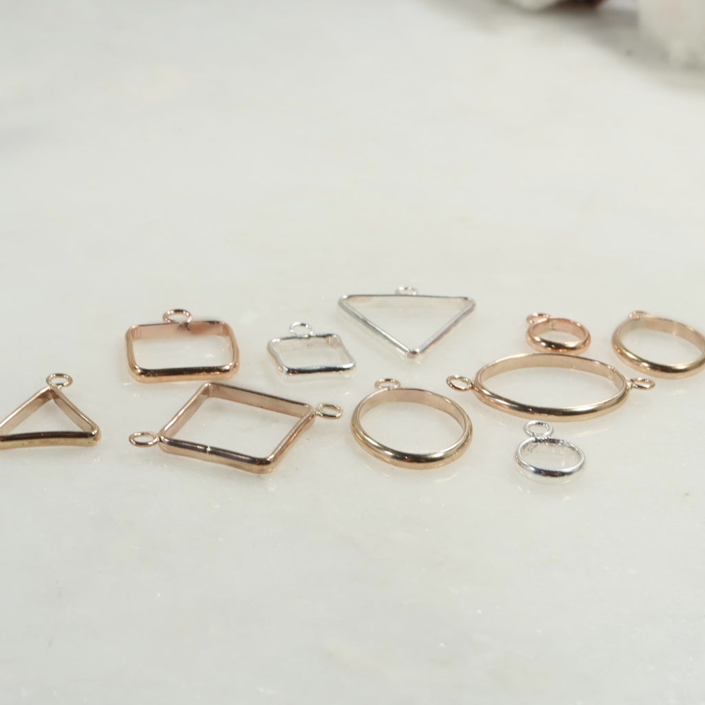 open bezels in gold, silver and pink gold